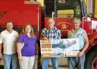 A donation to the New Haven-Berger Fire District was presented recently to the district board. From left to right are directors Wendy Krull, Norbert Horstmann, Sharon Wilson and Harold Englert, farmer Wayne Carl and director Kirby Menke.